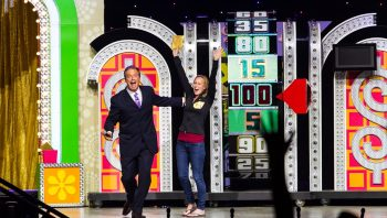 a contestant on stage with the host of The Price is Right Live