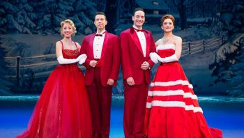 two couples from Irving Berlin's White Christmas posing in costume
